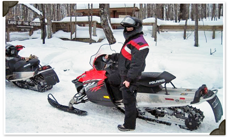Snowmobiling Recreation Outside The Resort Northern Wisconsin - This is what happens when you fly a snowmobile off a cliff